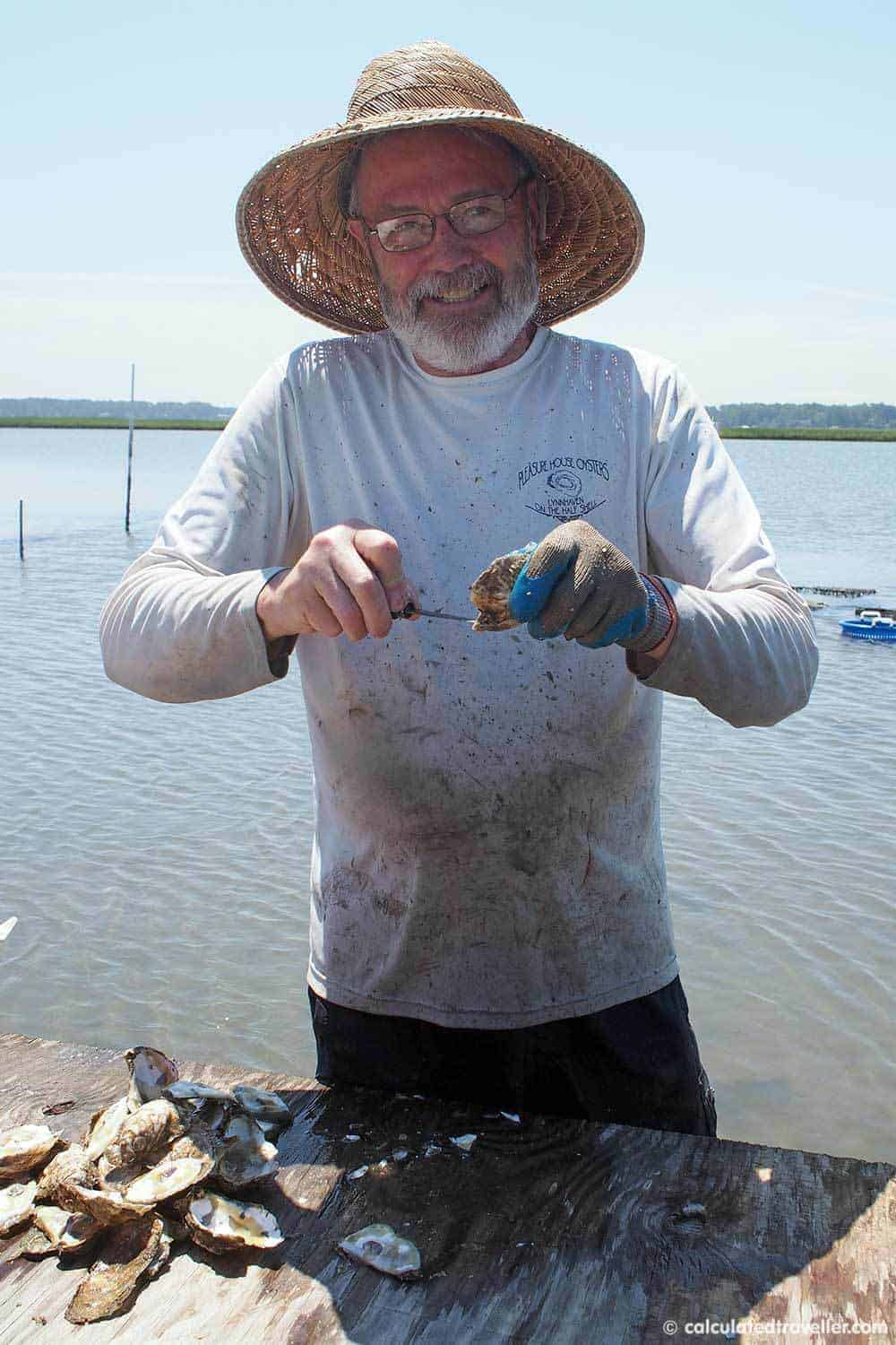A Pleasure House Oyster Tour in Lynnhaven Virginia - Captain Lee shucking oysters for us.