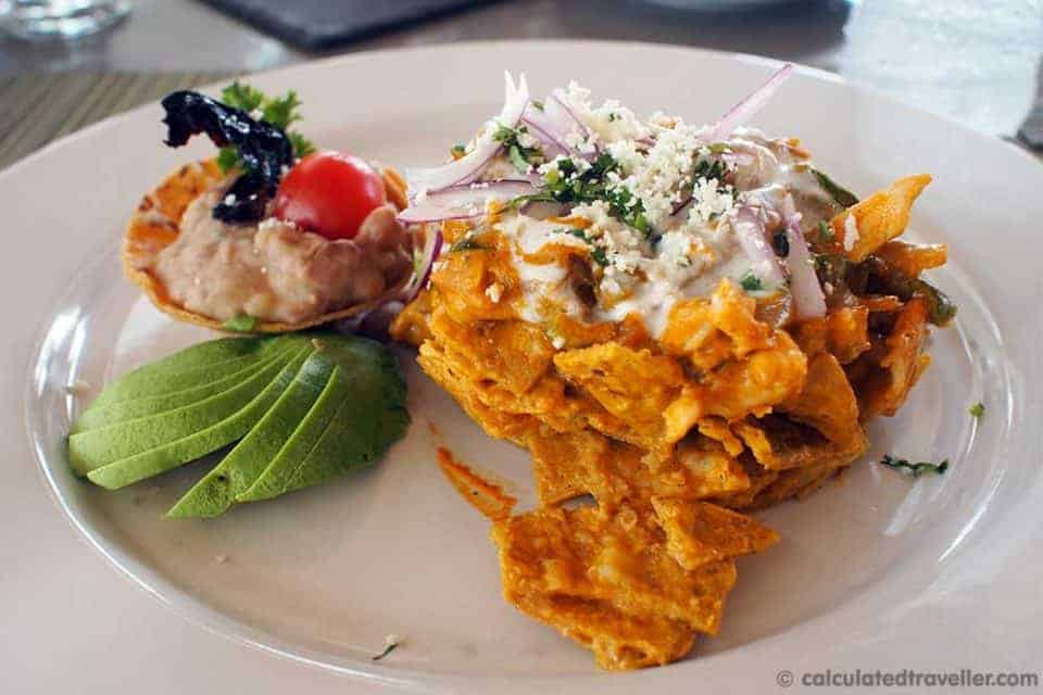 An All Inclusive Gourmet Experience at Villa Premier Boutique Hotel - Chilaquiles - Chicken, ham and roasted poblano pepper on top of corn chips.