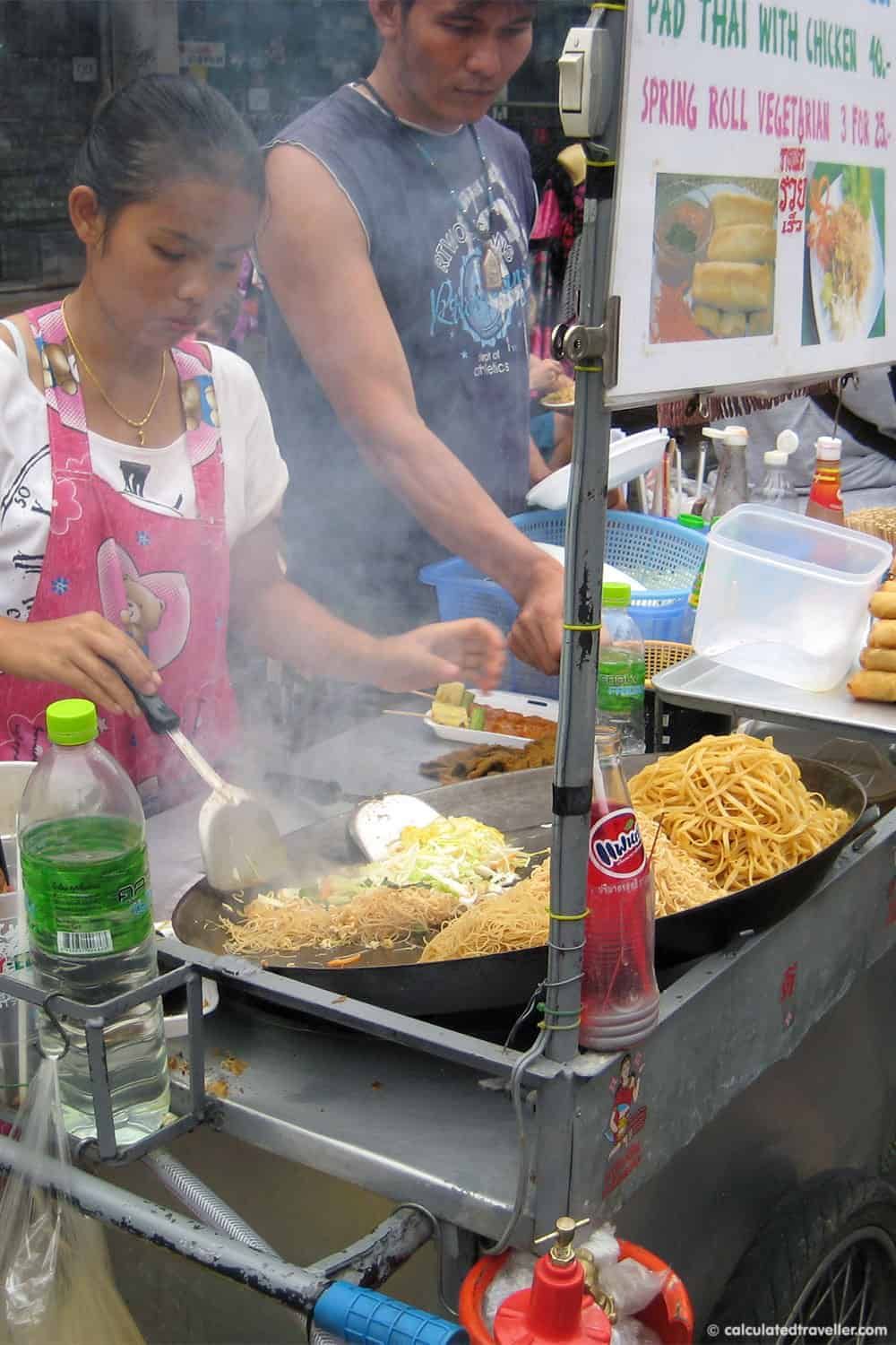 Eating out in Bangkok, Thailand - Street vendor frying noodles | #Bangkok #Thailand #noodles #food