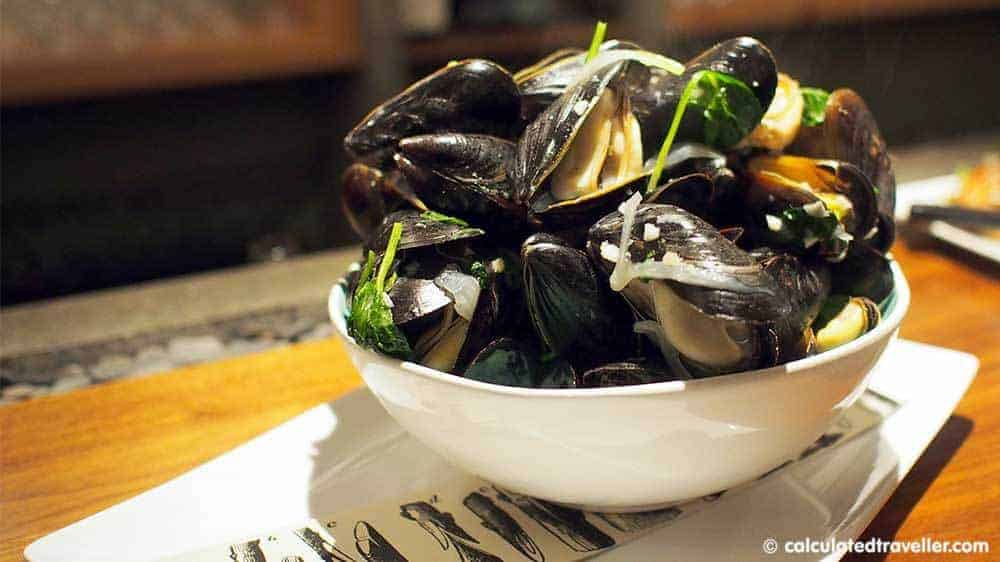 Graft Wine and Cider Bar, Watkins Glen New York Steamed Mussels with coconut milk broth, sweet onions, fresh ginger, local garlic and tatsoi