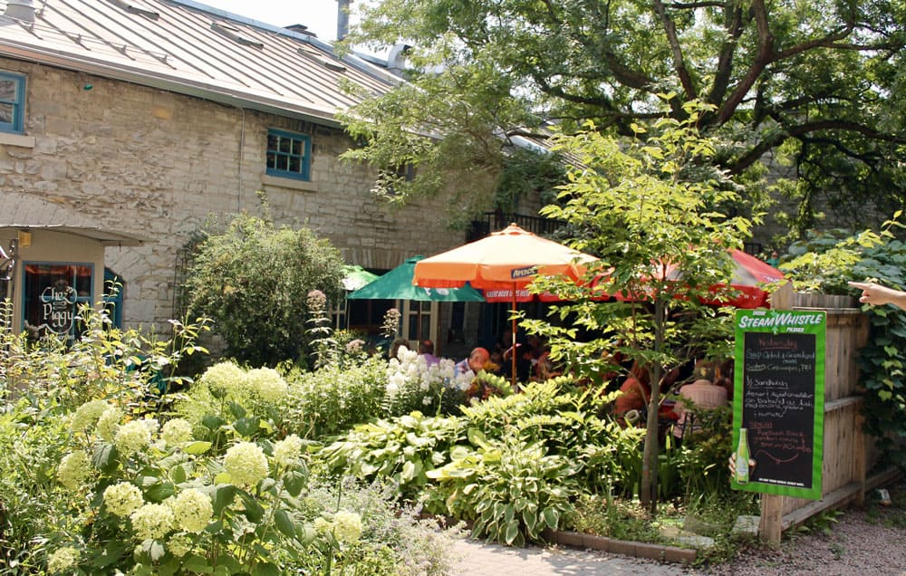 Welcome to the Limestone City of Kingston, Ontario - Exterior view of the patio at Chez Piggy