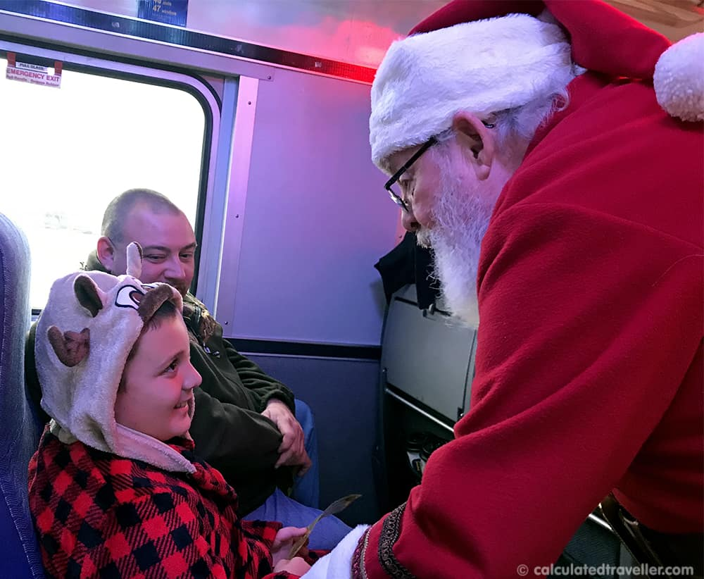 A Magical Experience Awaits on the Polar Express Train - Santa greeting child