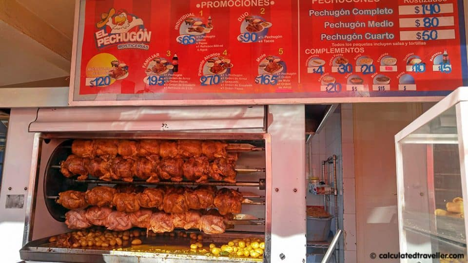 El Pechugon Rosticerias chicken being cooked on the rotisserie in Playa del Carmen Mexico