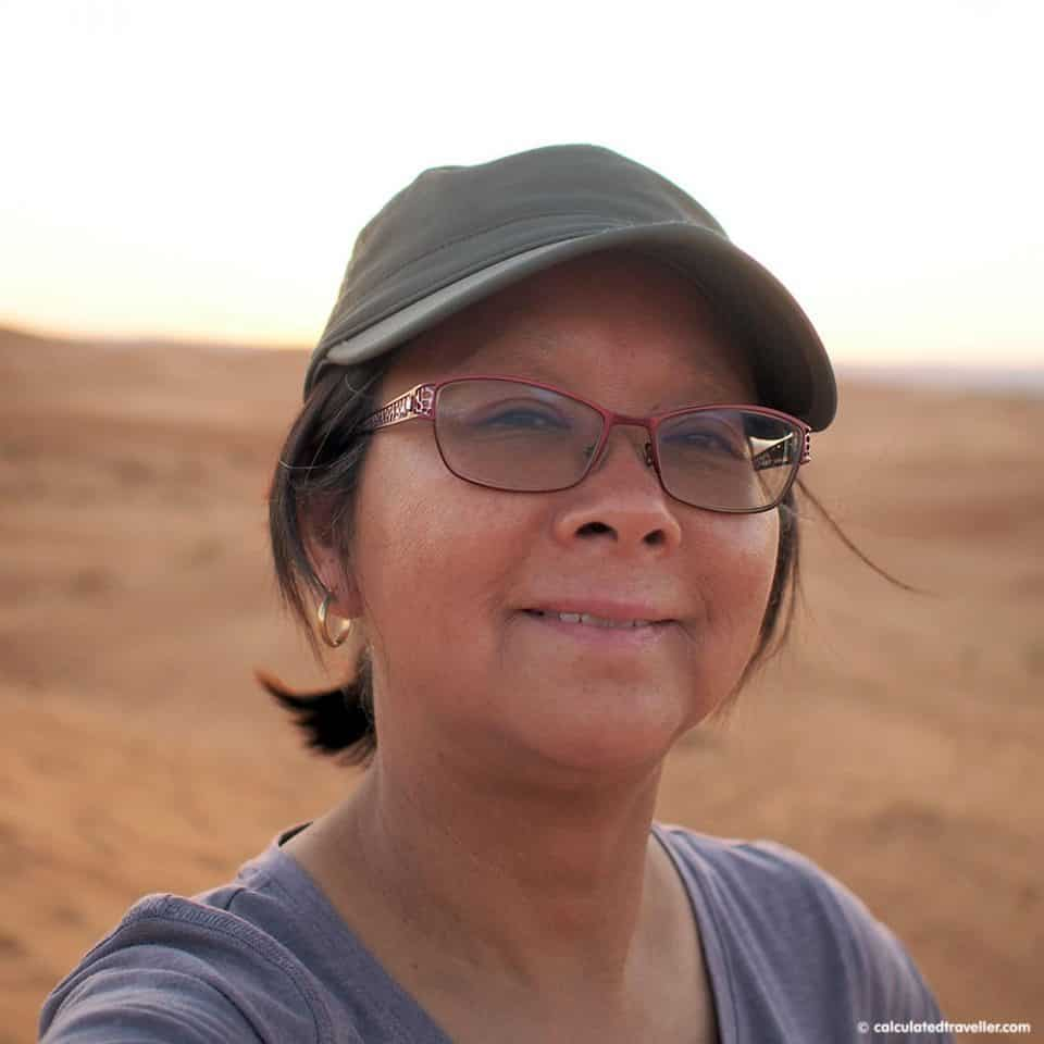 Calculated Traveller Mary wearing her Sunday Afternoons Sun Tripper Cap in the Moroccan desert