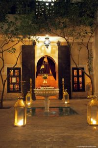 courtyard at night lit by candles