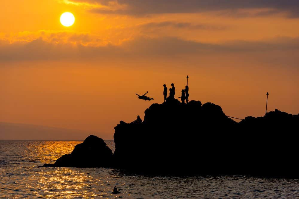 cliff diving at night