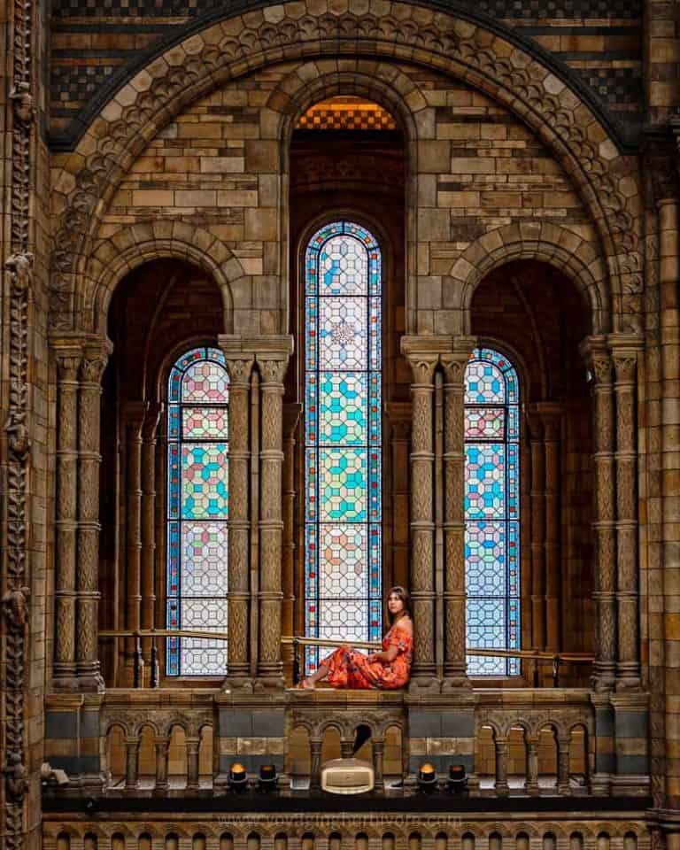 Interior view of girl sitting in the archway of a church
